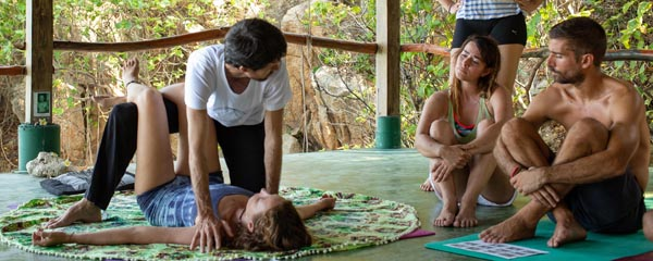 Yoga teacher demonstrating a technique during a teacher training